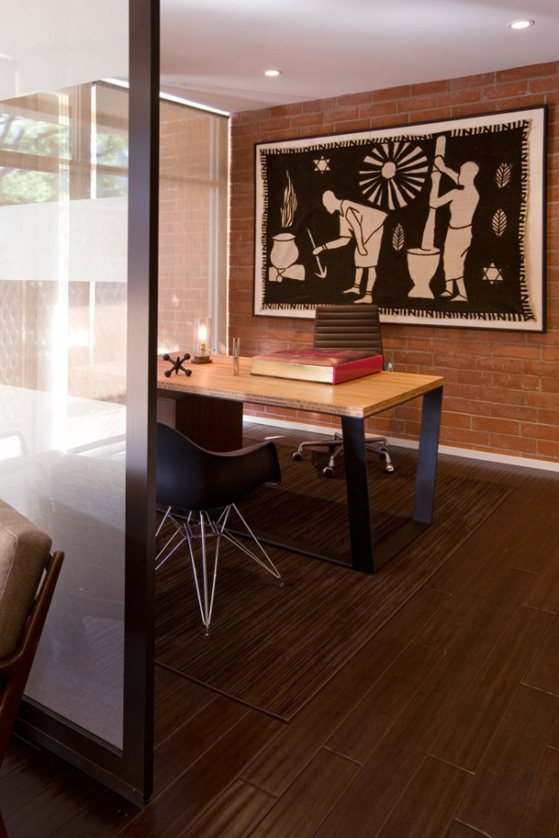 A peek towards the custom desk designed for the executive of this creative production office.