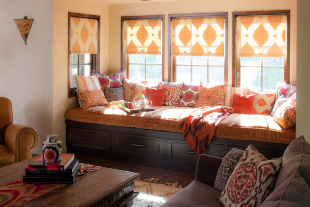 The daybed was outfitted in a relatively monochromatic play on reds and oranges, infusing a symphony of textiles with different textures and patterns to create a generous nook which embodies the warmth and color central to the client's vision.
