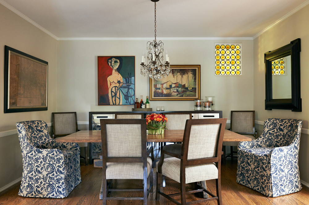 Another view showing the dining room connection to the kitchen and reveals the weathered, farmhouse style base of the table. A glimpse of the dining console reflects the antiqued mirrored fronts.