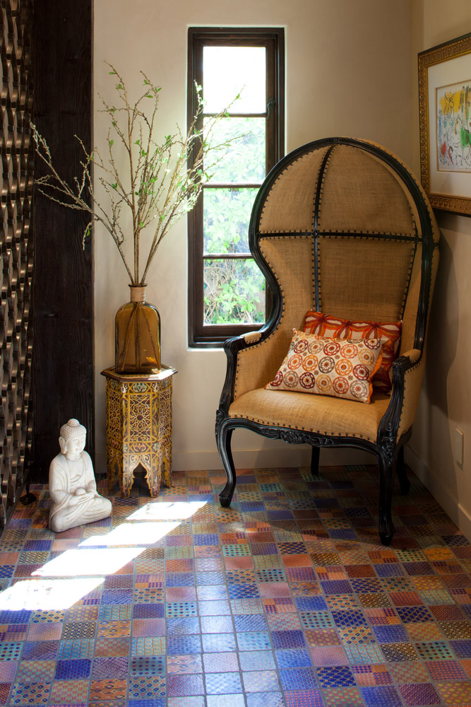 A small vignette inside the front door anchors the entry hall, complemented by the individually selected, hand-painted floor tile from France and the custom iron screen based on an archival image of an antique gate.